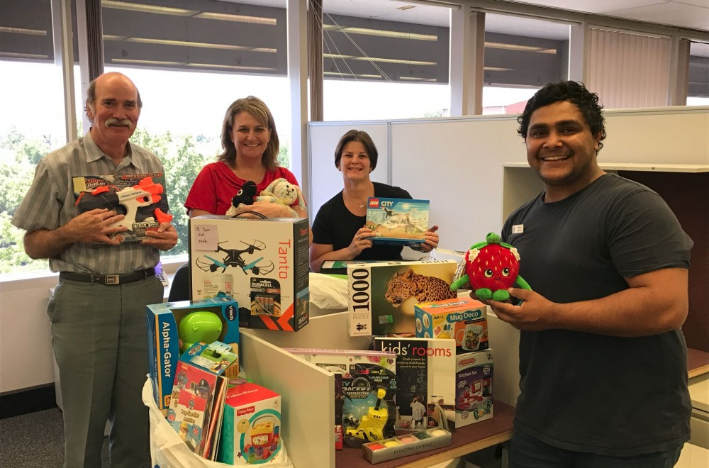 Department of Education staff in Bathurst generously supported the 2016 Veritas Xmas appeal. DEC staff (L-R) Peter Cole, Karyn Whalan and Roberta Lawson present their gifts to Veritas House Case Worker, Katon Crawford.